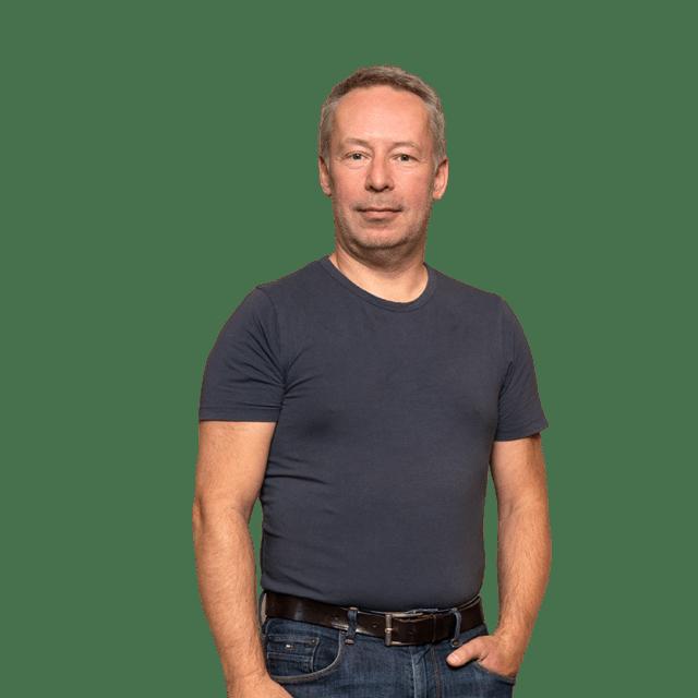 Andy Ribowski Abteilungsleiter Vorstufe in Arbeitskleidung bei von Stern'sche Druckerei