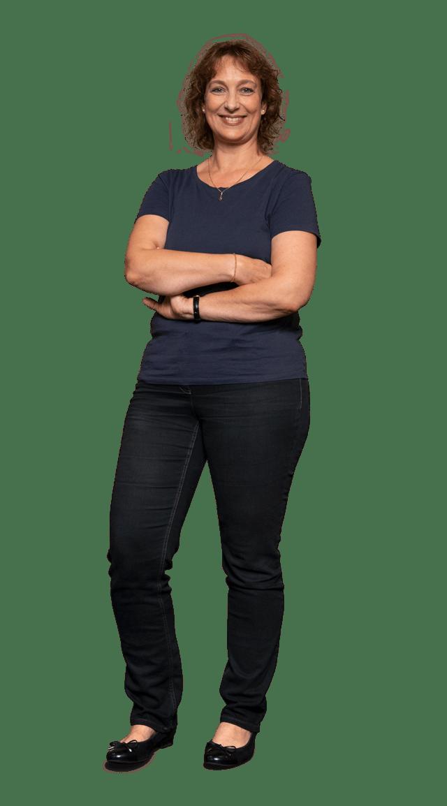 Bettina Brunke am Empfang in der Zentrale in Arbeitskleidung bei von Stern'sche Druckerei