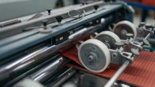 Maschine, um Druckerzeugnisse konfektionieren, heften und falzen zu lassen von Sternsche Druckerei